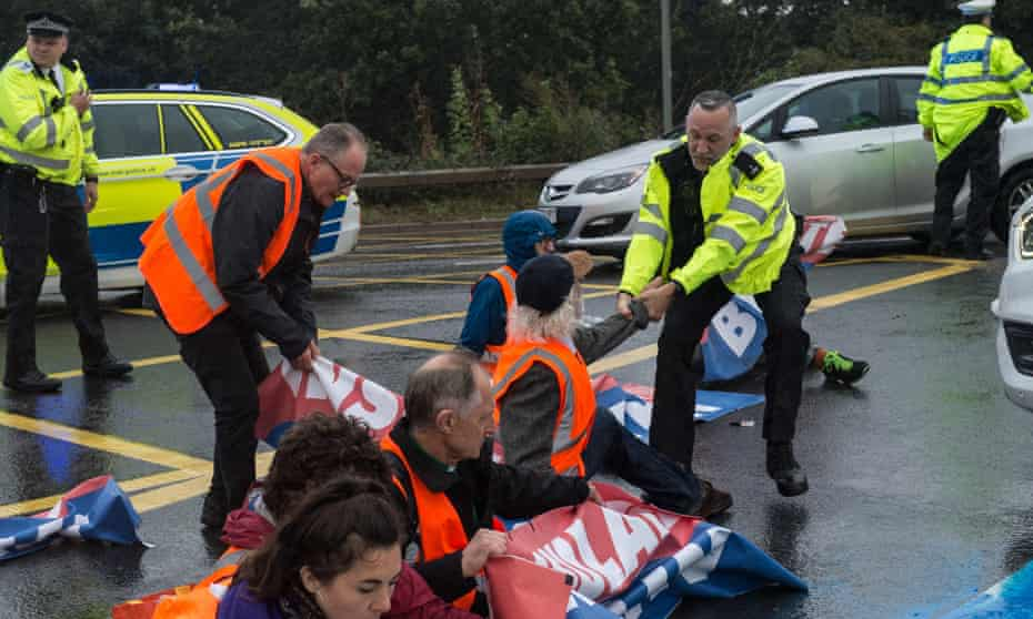 Police remove Insulate Britain protestors who were blocking a major roundabout near Heathrow airport in September.