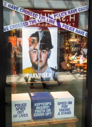 The 'spy cops' campaign material in the window of Lush's Cambridge shop