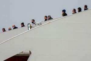 Passengers look out from Stena Line's Stena Edda ferry in Birkenhead