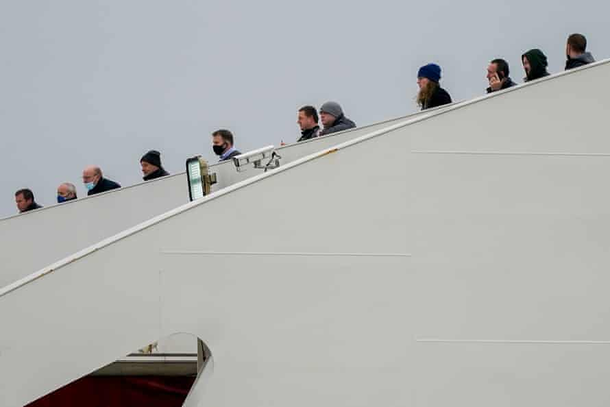 Passengers look out from Stena Line's Irish sea ferry Stena Edda at the company's River Mersey Birkenhead terminal