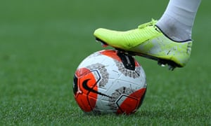 A football boot on a ball