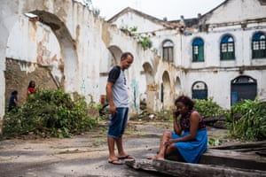Members of the Mariana Crioula squat come together to clear rubble