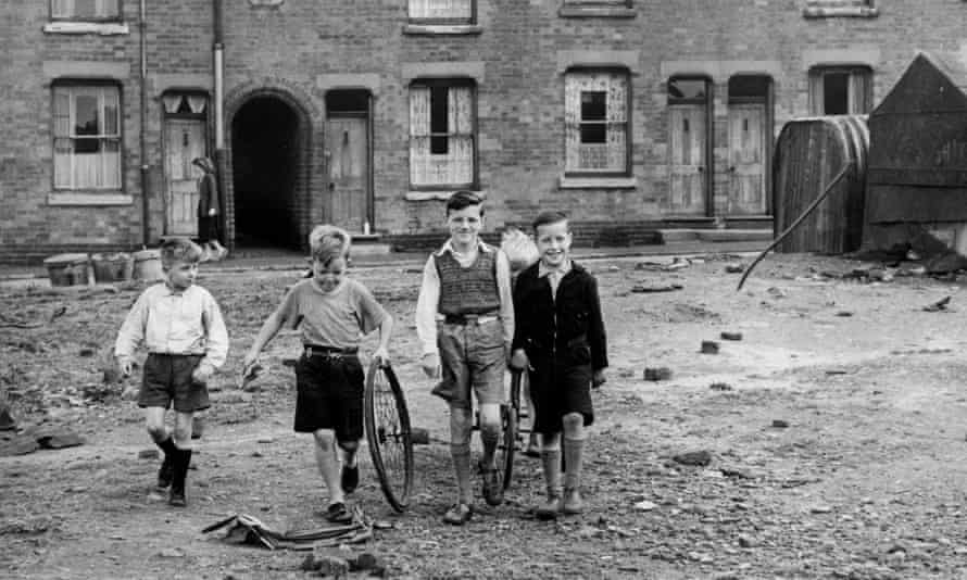Children playing in Birmingham, in an area that was earmarked for a playground, 1952.
