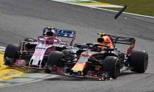 Esteban Ocon collides with the leader Max Verstappen