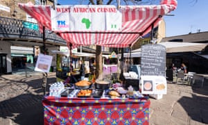 Fast food stall, with jollof rice on the menu.