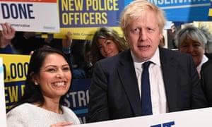 Prime Minister Boris Johnson and Home Secretary Priti Patel while on the general election campaign trail last December.