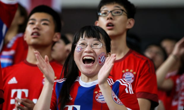 Chinese fans of Bayern Munich cheer for the team before a pre-season friendly against Internazionale in Shanghai in July.