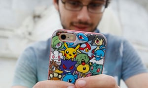 A player's phone is decorated with Pokemon stickers as he plays Pokemon Go in London on Saturday.