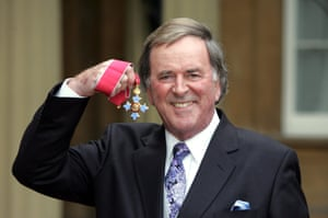 Terry Wogan shows off his OBE award at Buckingham Palace in 2005