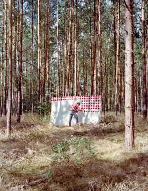 """Photographs of paintings being made in the Austrian Alps copying the colours of his knitwear by Berlin-based photographer Fabian Schubert and artist Hank Schmidt in der Beek in a series called Und im Sommer tu ich malen ("""" And in summer I do paint """")"""