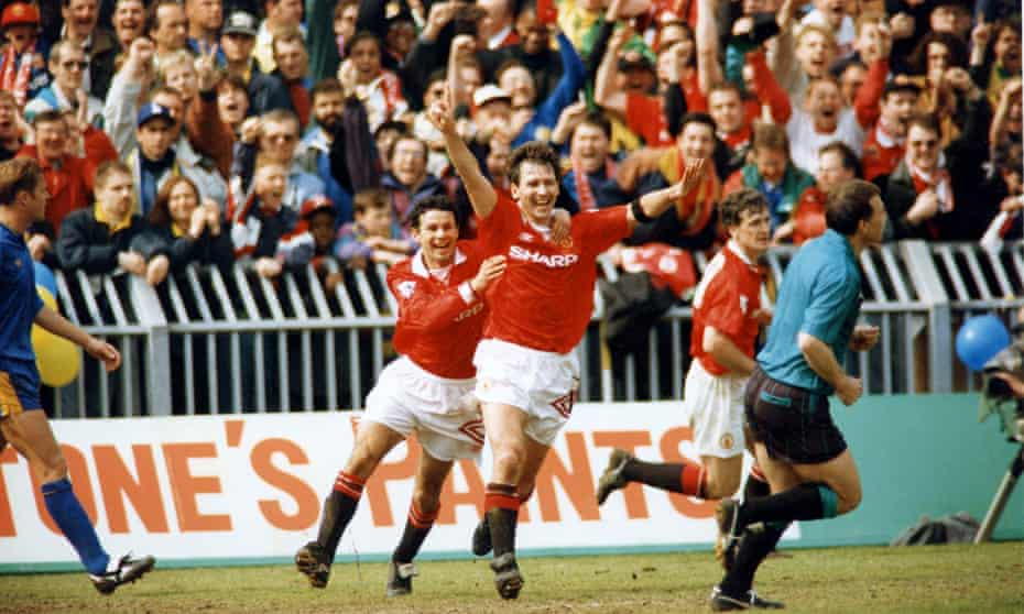 Bryan Robson celebrates after scoring against Wimbledon in the final game of the 1992-93 season.