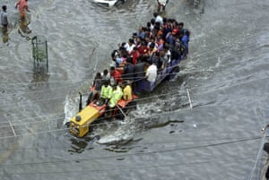 People are rescued in a tractor from a flooded area in Patna, India