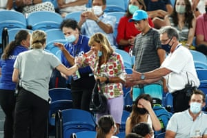 A spectator, who had been shouting at Rafael Nadal and flicking the bird, is asked to leave by security.