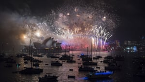 Fireworks explode above the opera house and harbour bridge on New Year's Eve in Sydney.