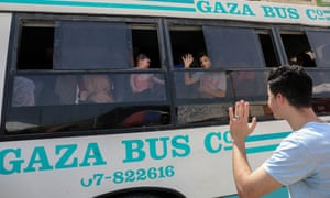 Palestinians wait to travel to Egypt through the Rafah border crossing on Friday.