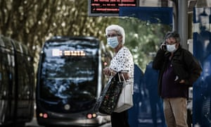 Commuters wearing protective face masks in Bordeaux