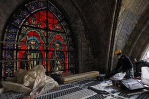 Workers near a stained glass window at the reconstruction site of the Notre-Dame de Paris Cathedral