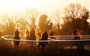 Horses and jockeys on the gallops during the stable visit to Gordon Elliott's yard at Cullentra House, County Meath, Ireland
