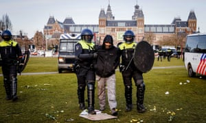 Police detains a protester on the Museumplein at Museumplein, Amsterdam, Netherlands, 31 January 2021.
