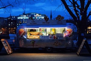By Alison Savvides. Wandering along London's South Bank at dusk in mid-winter, I was drawn to this scene by the colours and symmetry. The image shows a food and beverage truck on the promenade overlooking the river Thames.