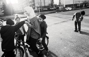 Iraqi, Syrian and Kurdish children play outside their hostel in Schonefeld