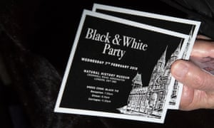 A guest holds invitations for the Conservative party Black and White ball at Natural History Museum.