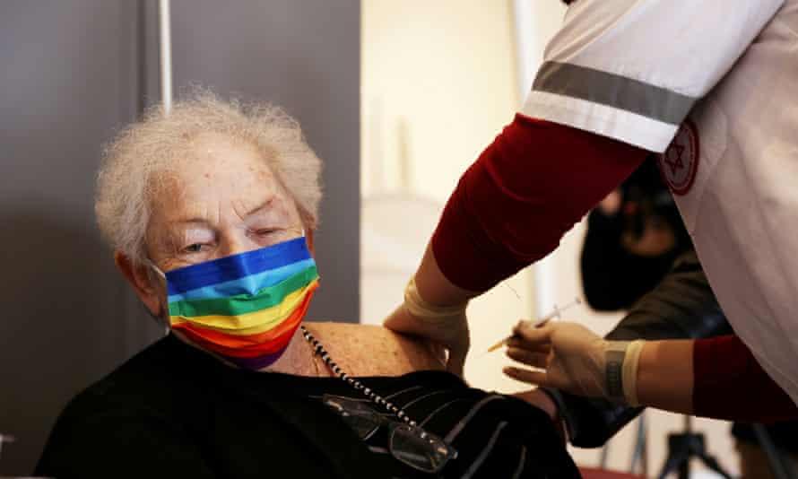 An Israeli woman receives a Covid vaccine booster shot in Netanya