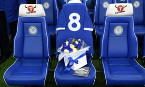 Flowers and a vintage No 8 shirt were placed on the assistant manager's seat in the home dugout at Stamford Bridge in tribute to the late Ray Wilkins.