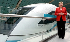 German Chancellor Angela Merkel stands in front of a Transrapid train in Shanghai, China, Tuesday, 23 May 2006. Merkel rode the world s first commercial maglev Transrapid train to the Shanghai airport Tuesday to catch her flight back to Berlin.