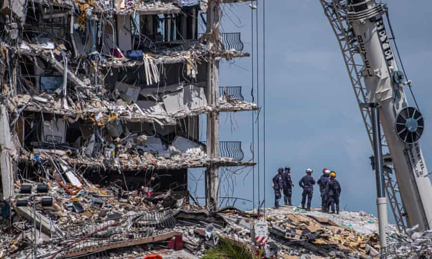 Members of the South Florida Urban Search and Rescue team look for survivors in the partially collapsed 12-story Champlain Towers.