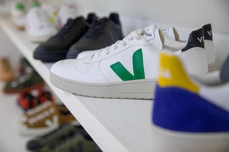A pair of V-10 Veja shoes sits among a wall of designs at the company's HQ.