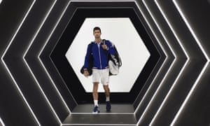 Novak Djokovic arrives on court to face Andy Murray.
