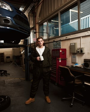 Spencer Wood, 33, prototype mechanic, Ford Dunton Technical Centre, Basildon, Essex, wears a Katharine Hamnett jumpsuit at his workplace