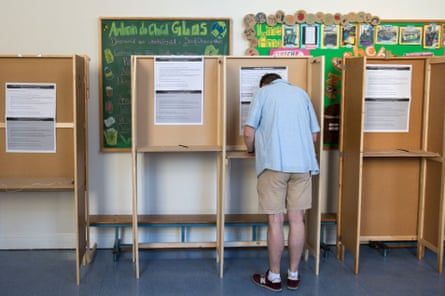 A voter prepares his ballot paper at the Marlborough Street National School polling station in Dublin.