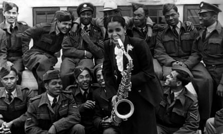 Blues singer Mona Baptise with some of the 409 West Indians on the ship in 1948.