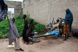 A family that fled from the town of Kadunga a year ago and are now living in an abandoned building on the outskirts of Maiduguri.