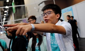 Joshua Wong celebrates after Nathan Law wins seat