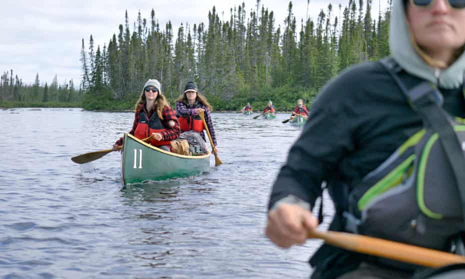 Female canoeists on a river in Quebec