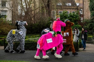 Contestants make their way to the start of the London Pantomime Horse Race.
