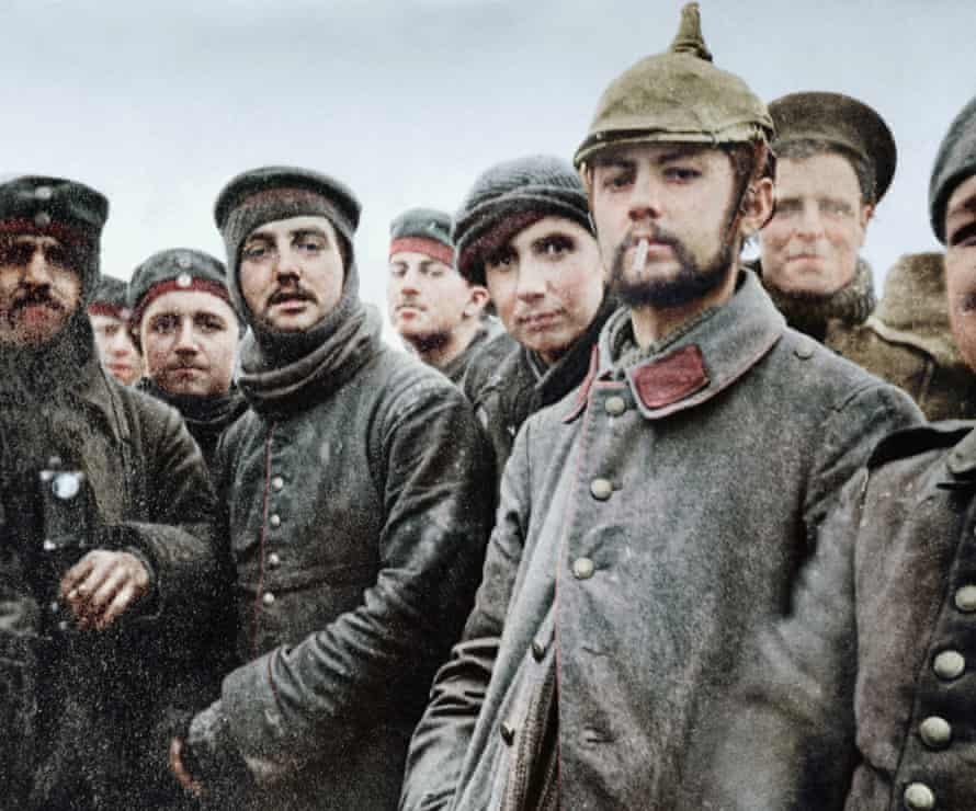 5th London Rifle Brigade soldiers with German Saxon regimental troops at Ploegsteert Wood, on the western front, during the Christmas truce in 1914: black and white image coloured by artist Marina Amaral