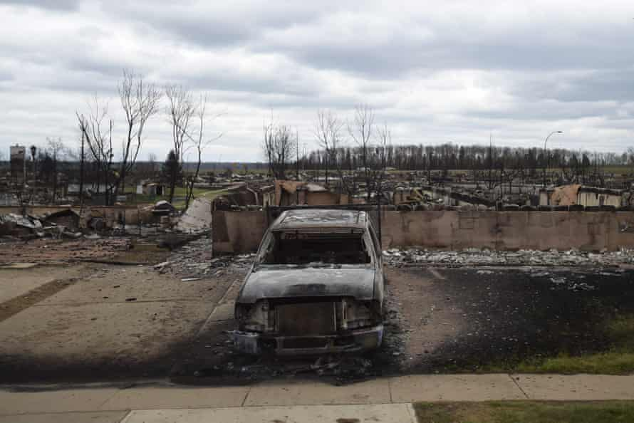 A burned-out vehicle in the Beacon Hill neighbourhood of Fort McMurray.