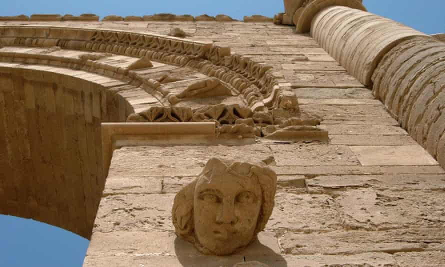 A carved boss of a woman's face on the Hatra ruins in Iraq, which have reportedly been demolished by Isis militants, who have also looted artefacts from Nimrud and bulldozed the 3,300-year-old site.