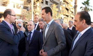 Picture released by Syrian state media shows Bashar al-Assad speaking with press in Daraya