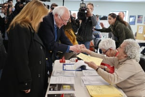 Democratic presidential candidate Sen. Bernie Sanders (I-VT) and his wife Jane O'Meara Sanders greet poll workers before voting in their state's primary election at the Robert Miller Community Center March 03, 2020 in Burlington, Vermont. Voters in 14 states are going to the polls on Super Tuesday.
