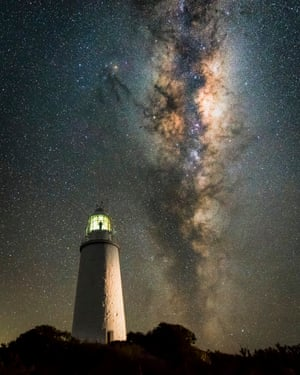 Keeper of the LightJames Stone (Australia). The Milky Way rises above an isolated lighthouse in Tasmania. The photographer planned his position to shoot the perfect composition positioning the Milky Way in conjunction with the lighthouse and observing how to best light the tower for artistic effect. This image is part of a time-lapse sequence, allowing the photographer some time to climb the tower into the lantern room of the lighthouse and reflect on the hard and lonely, yet incredible life the former lighthouse keepers would have lived.