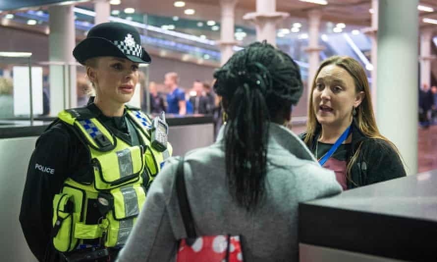 A British Transport Police officer and Metropolitan Police Constable talks to a woman arriving on the Eurostar from Brussels as officers from the Metropolitan Police Service, British Transport Police, Kent Police and UK Border Force take part in Operation Limelight at the Eurostar terminal at St Pancras International in London, which is aimed at safeguarding children and vulnerable people from harmful practices and human trafficking.