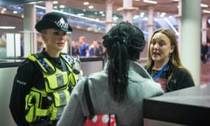 A British Transport Police officer and Metropolitan police constable talk to a woman arriving on the Eurostar from Brussels.
