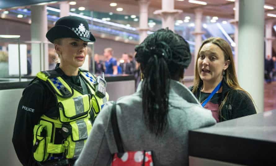 A passenger on a Eurostar train is questioned on arrival in the UK.