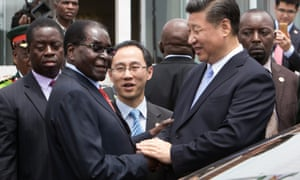 Chinese president Xi Jinping shakes hands with Robert Mugabe on a 2015 trip to Harare.