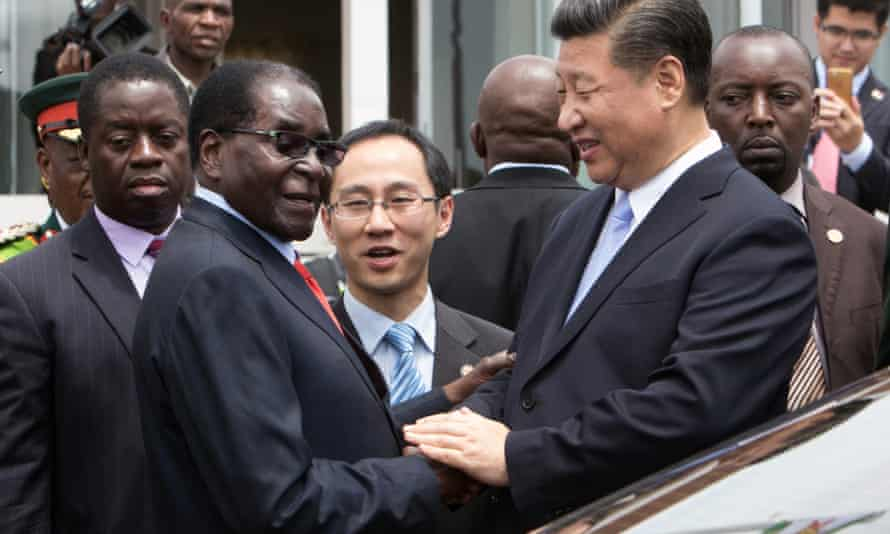 Robert Mugabe shakes hands with Xi Jinping as the Chinese president arrives in Harare on Tuesday.
